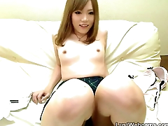Cute Japanese girl toys her hairy pussy chiefly cam